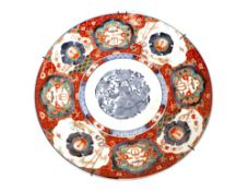 A large Japanese Imari charger, decorated in the traditional palette, 46cm dia.