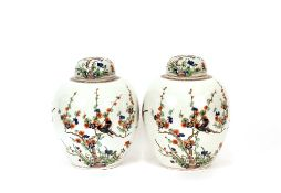 A pair of Chinese ginger jars and covers, having floral and bird decoration, 31cm high