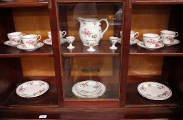 An Aynsley tea set comprising six tea cups and saucers, three small plates, six medium plates, and a