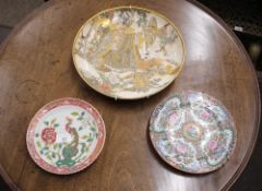 A Satsuma plate, decorated central mystical figures in a forest - some damage; a Canton plate