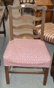 A pair of 19th Century provincial oak ladder back dining chairs, raised on square chamfered supports