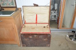 A leather and canvas dome topped travelling trunk