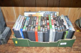 A box of various DVD's and video games