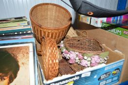 A box of various small wicker baskets