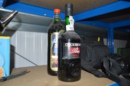 A bottle of Cockburns port; and a bottle of Christ