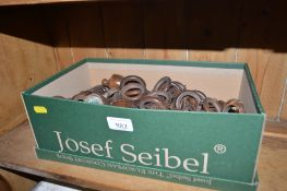 A box containing various curtain rings etc.