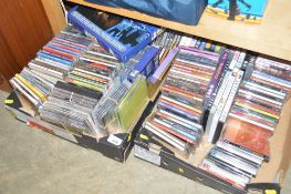 Two boxes of various CD's and DVD's