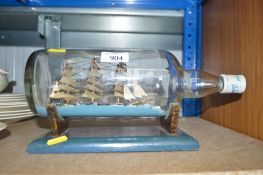 A ship in bottle ornament on stand