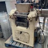 A cast metal commercial dough manufactur
