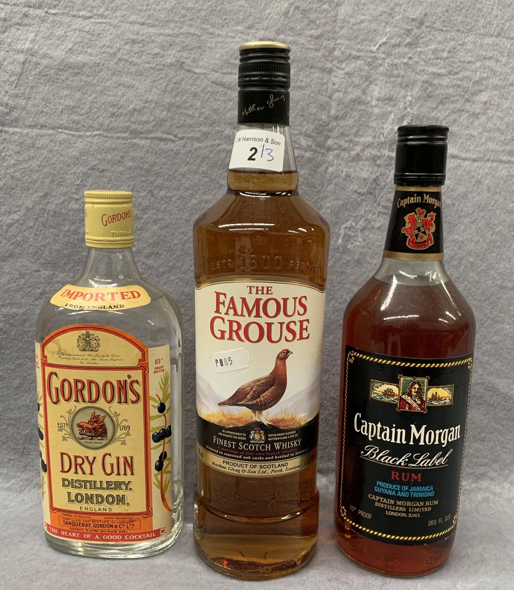Lot 2 - A 1 litre bottle of Famous Grouse Whisky, a 26.