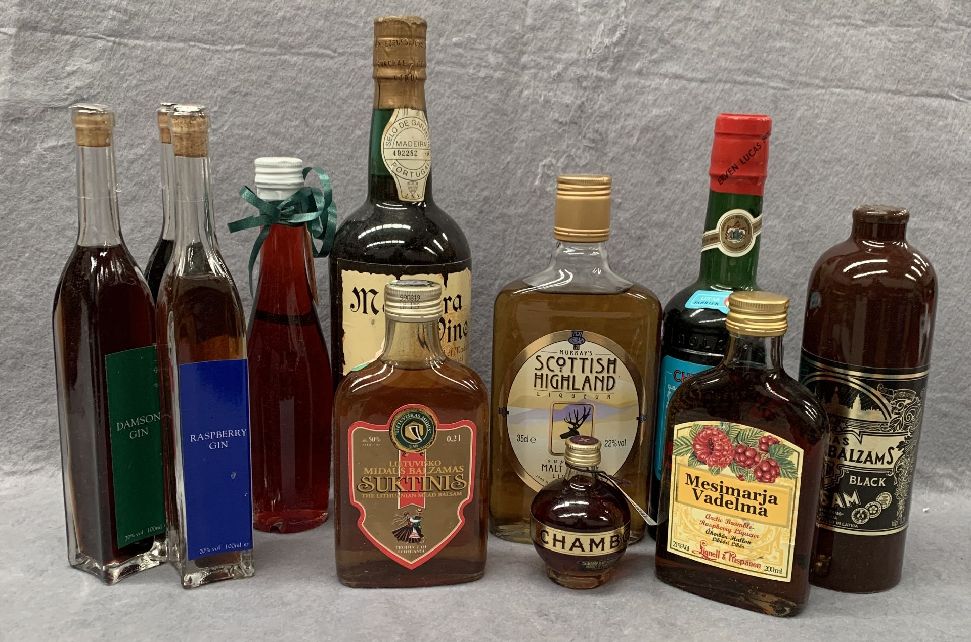Lot 6 - 11 various sized bottles to include flavoured gins (100ml), bottle of Madeira wine,