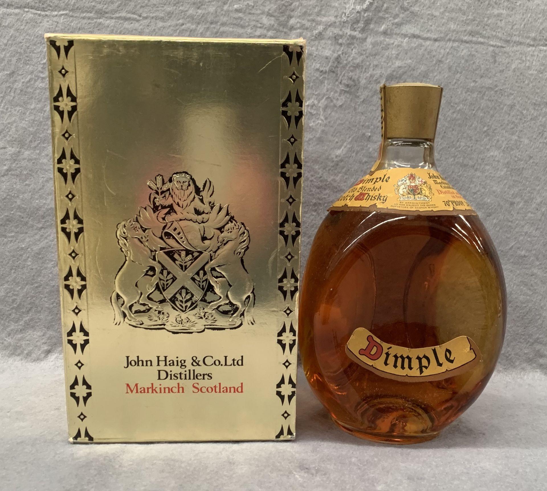 Lot 12 - A John Haig & Co Ltd 26 2/3 fl oz bottle of Dimple Old Blended Scotch Whisky in presentation box