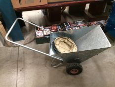 A Westphalia galvanised two wheel wheelbarrow and a folding collection bag