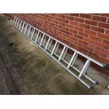 An aluminium 30 rung double extension ladder