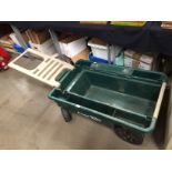 An Ames green moulded plastic planters wagon 100 x 64 x 20cm deep