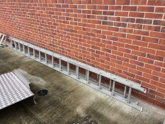 An aluminium 32 rung double extension ladder