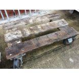 A heavy duty wood framed 4 wheel bogey