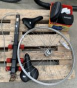 Contents to part of pallet - bike wheel, 2 bike saddles by Trek and VL1, part bike rack for cars,