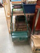 A green metal garden roller 42cm diameter