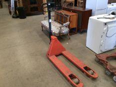 A Rolatruc orange pallet truck