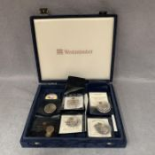 A Westminster Coin box and contents,
