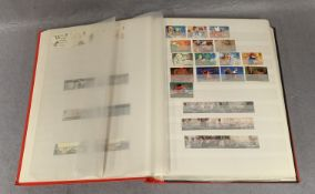 A stamp album containing UK 21st century stamps