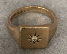 A 9ct gold signet ring set with a small diamond, approximate weight 7.