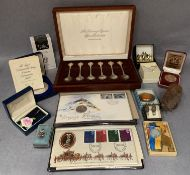 Contents to tray - a set of six silver sovereign Queens Spoon Collection Members Edition in case,