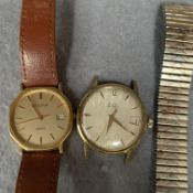 A Bulova quartz gentleman's wristwatch with brown leather strap and an Avia Olympic watch face (2)