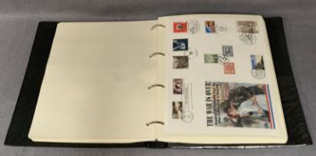 A Westminster album containing The History of World War II stamp and coin commemorative covers