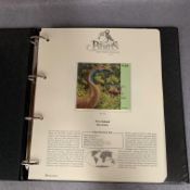 A Westminster Album containing Birds of the World stamps and information pages