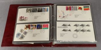 An album containing 130 Royal Mint First Day Covers,