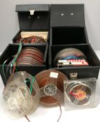 Assorted reel tapes and four black vinyl cases