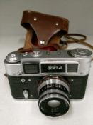30-4 camera S/N 344528 with tan leather case