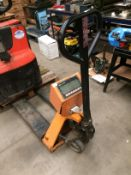 An orange and black metal pallet truck fitted with a U/UT - scales model TPS-11 with digital