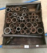 Metal tray containing approximately 42 various sockets