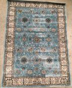 An Oriental style rug in light blue,