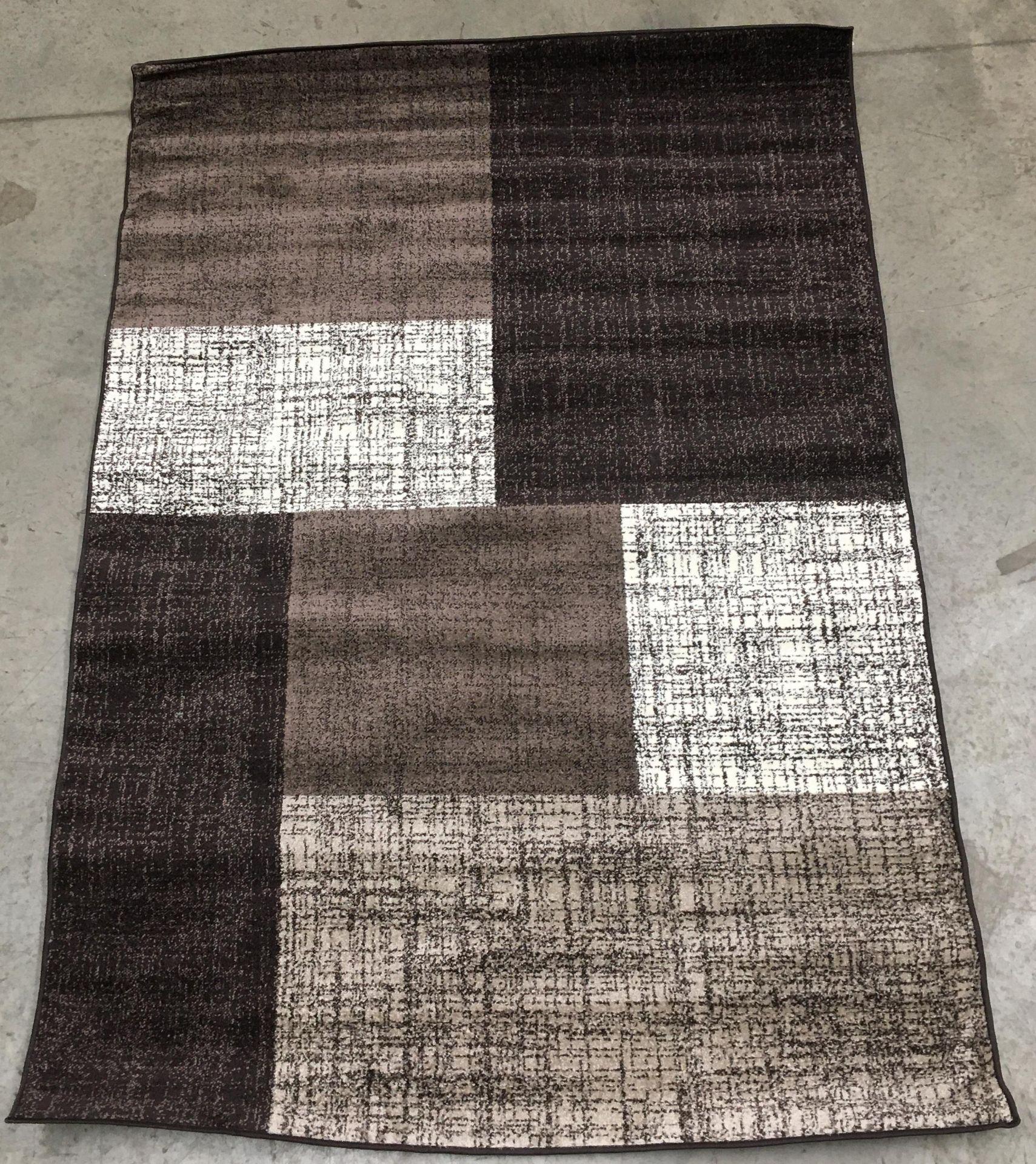 Lot 18 - A Paco Home Mondial 105 brown rug - 160cm x 230cm