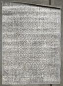 A grey and white floral patterned rug - 120cm x 170cm