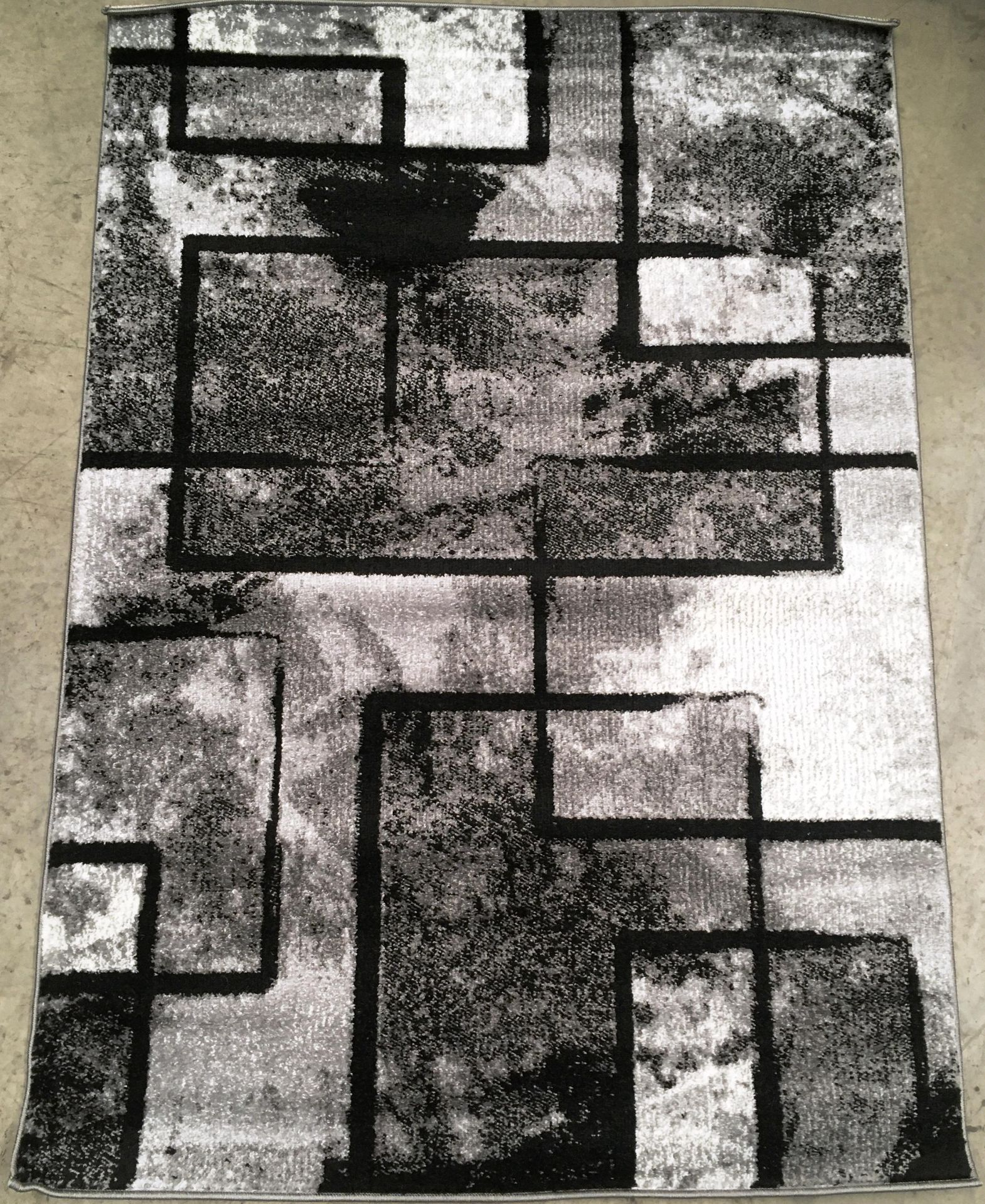 Lot 6 - A Paco Home Mondial 101 grey rug - 120cm x 170cm