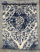A blue and grey patterned rug - 90cm x 150cm