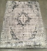 A modern grey and beige faded patterned short pile rug - 220cm x 160cm