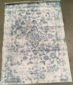 A white and light blue patterned rug - 170cm x 120cm