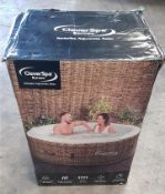 CLEVERSPA BORNEO 4 PERSON HOT TUB. LABEL ON BOX STATES 'DAMAGED'.