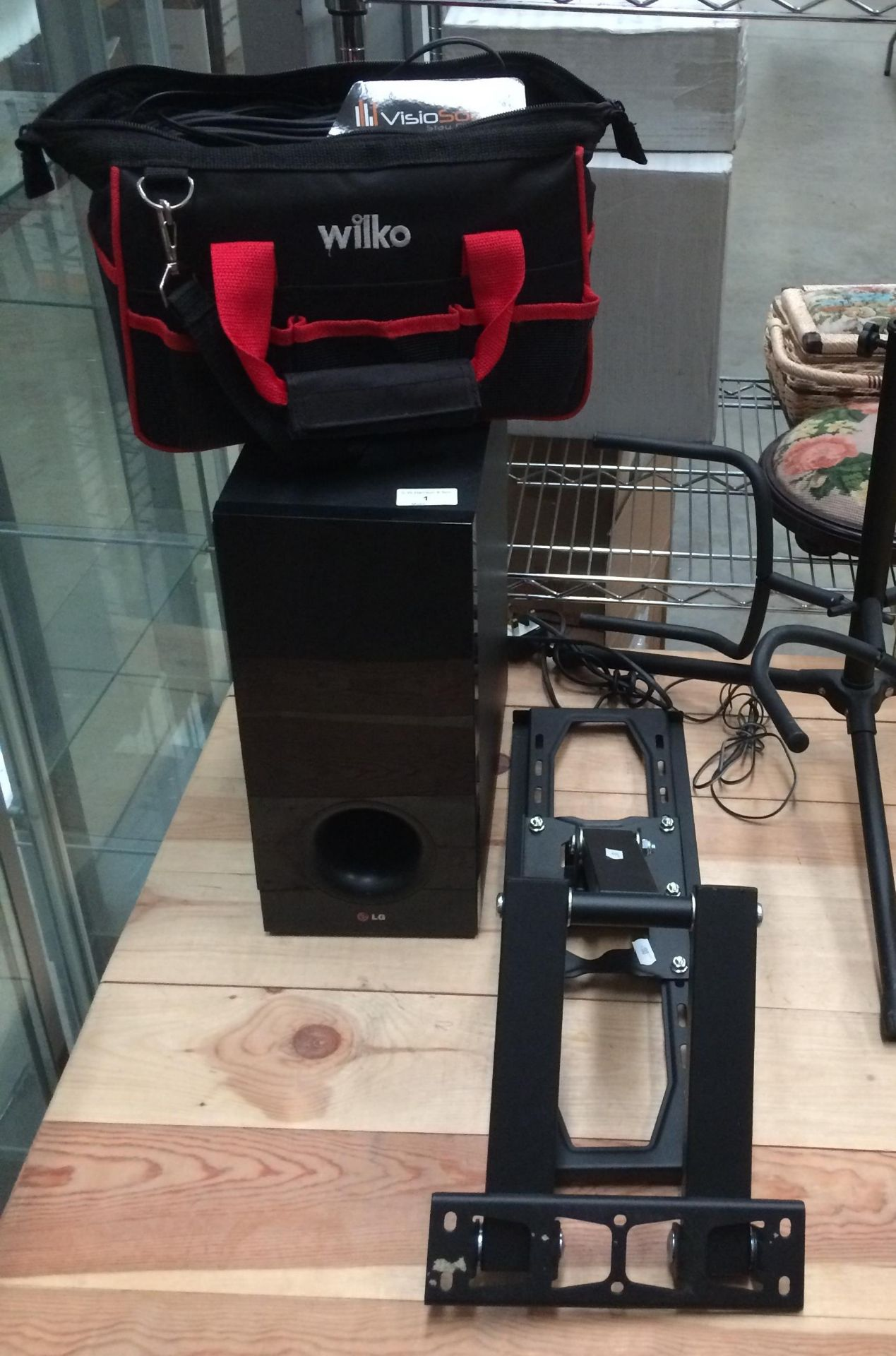 Lot 1 - LG 533A1-D active subwoofer, TV wall bracket, music stand, large quantity of audio cables,