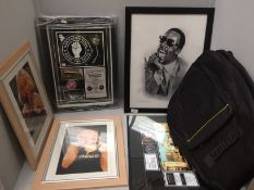 Guitar bag and 5 x framed prints of music artists