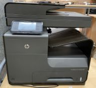 An HP OfficeJet Pro X476dw mfp printer