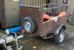 A single axle wood framed trailer,