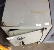 A light grey metal safe,