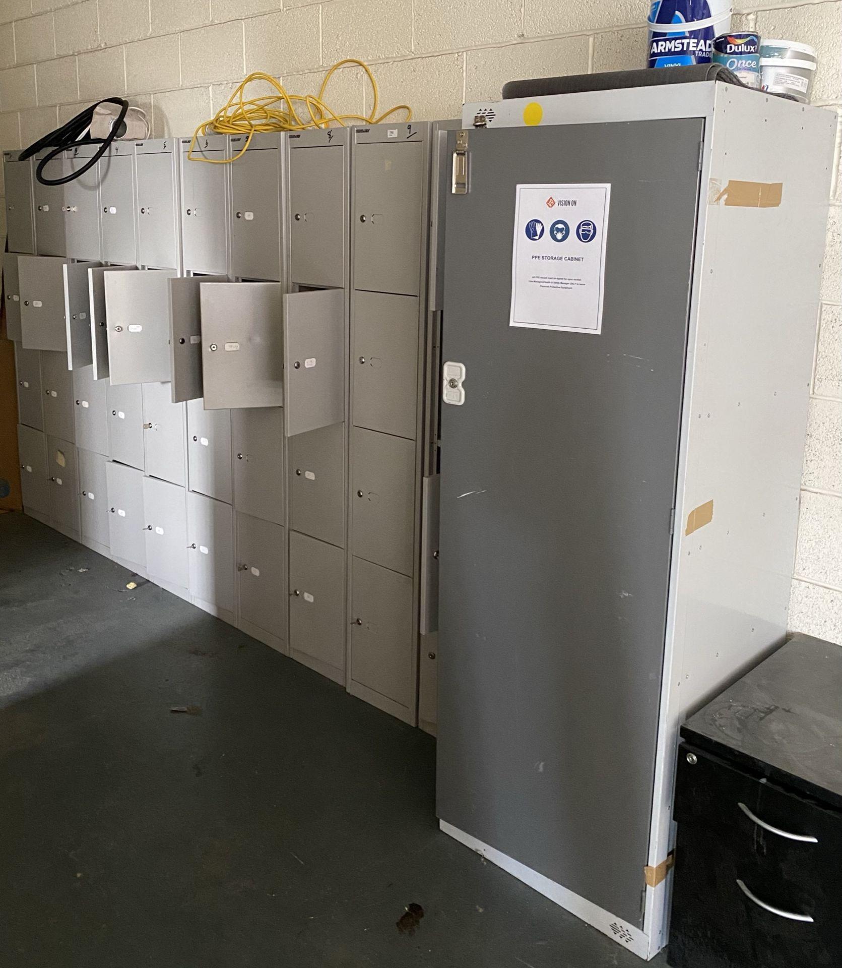 10 bays of 4 door grey metal lockers and